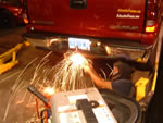 Me cutting the cross threaded ball hitch off the bumper