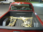 Extra parts tied down in the truck bed